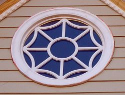 Legacy Round Direct Set Window with R6 gothic grid pattern.